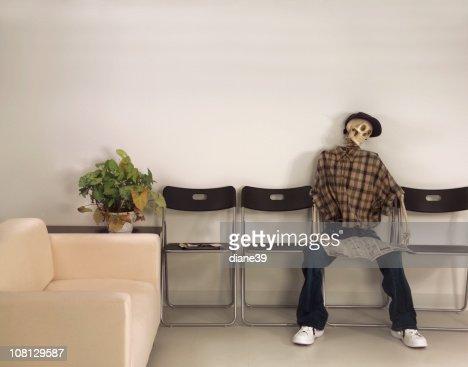 Skeleton Man Sitting Waiting Room with Newspaper