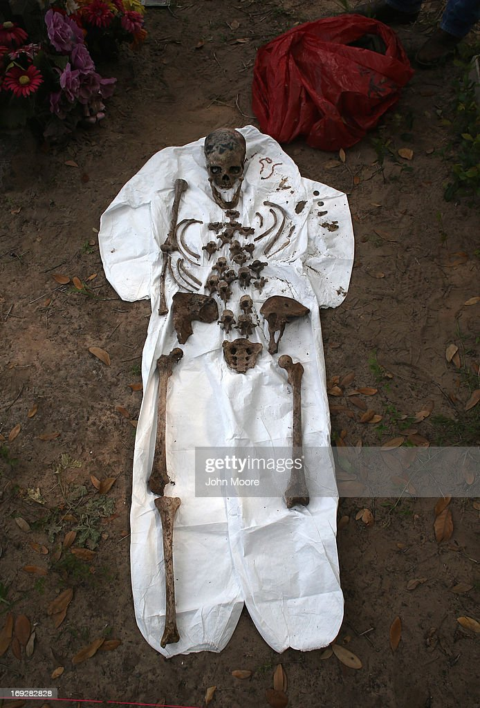 A skeleton of a suspected undocumented immigrant lies partially reassembled after it was exhumed from a gravesite on May 22, 2013 in Falfurrias, Brooks County, Texas. In Brooks County alone, at least 129 immigrants perished in 2012, most of dehydration while making the long crossing from Mexico. Teams from Baylor University and the University of Indianapolis are exhuming the bodies of more than 50 immigrants who died during their journey. The bodies will be examined and cross checked with DNA sent from Mexico and Central American countries, with the goal of reuniting the remains with families.