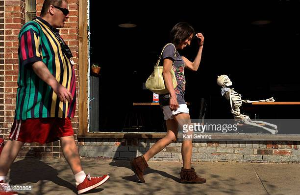 A skeleton sat at a table near the front window of a drinking establishment called The Bar at 554 South Broadway Wednesday afternoon March 28 2012...