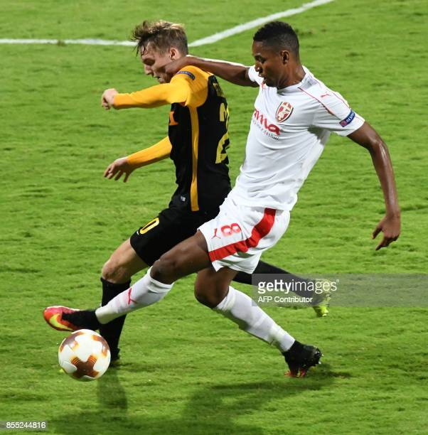 Skenderbeu's Bakary Nimaga vies for the ball with Young Boys' Michel Aebischer during the UEFA Europa League Group B football match between KF...