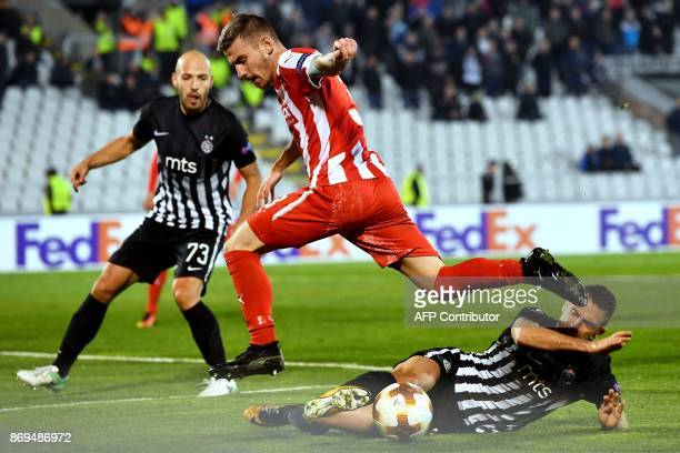 Skenderbeu's defender Gledi Mici vies with Partizan's defender Miroslav Vulicevic during the UEFA Europa League Group B football match between...