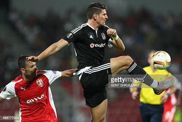 Skenderbeu's Renato Arapi vies with Besiktas' Mario Gomez during the UEFA Europa League Group H football match between KF Skenderbeu and Besiktas JK...