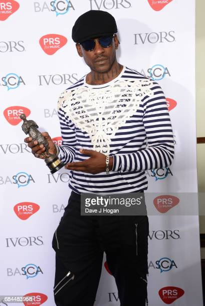 Skepta poses in the winners room with the Songwriter of the Year award at the Ivor Novello Awards at Grosvenor House on May 18 2017 in London England