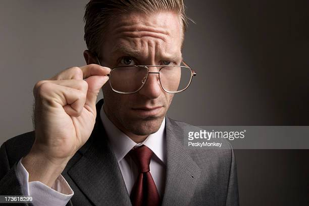 Skeptical Businessman Takes a Closer Look