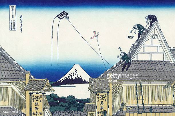 A Sketch of the Mitsui Shop in Suruga in Edo from the ukiyoe series '36 Views of Mt Fuji' Depicts flying kites and rooftilers at work Color woodblock...