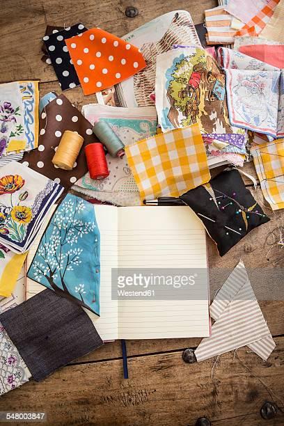 Sketchbook and cloth samples on work desk