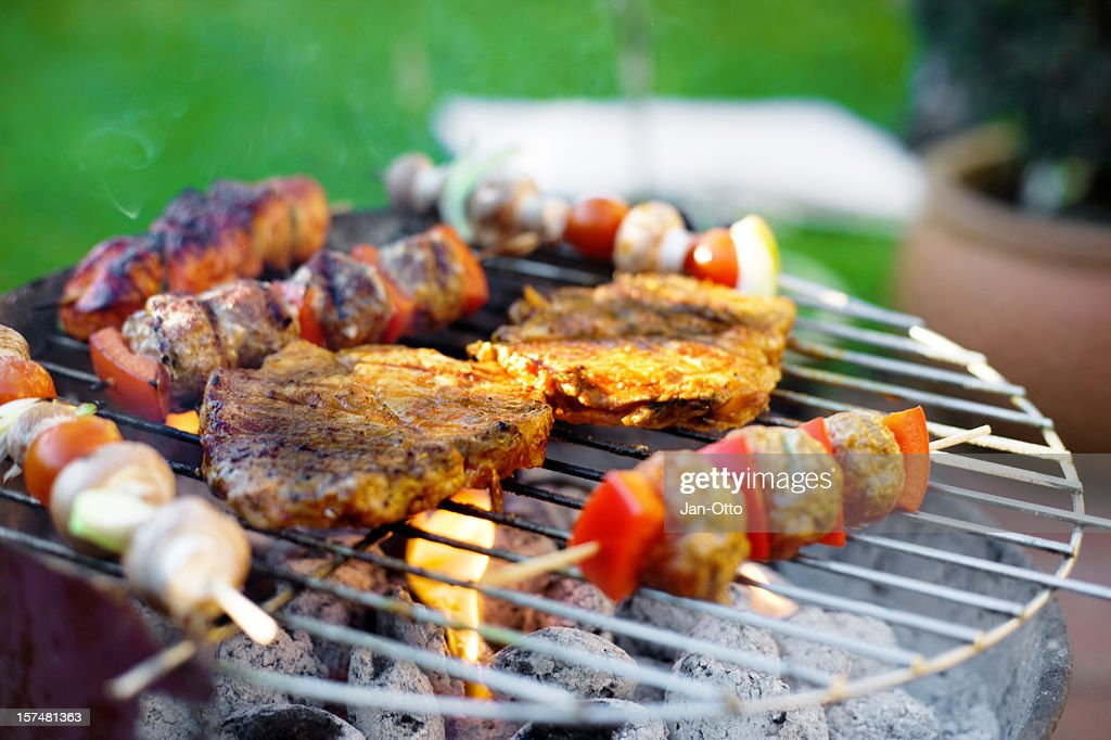 Skewer and meat on grill