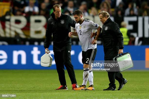 Skhodran Mustafi of Germany is injured during the FIFA 2018 World Cup Qualifier between Germany and Azerbaijan at FritzWalterStadion on October 8...