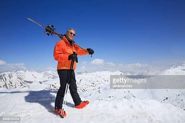 Ski Active senior men snow skier enjoying High snowy mountain