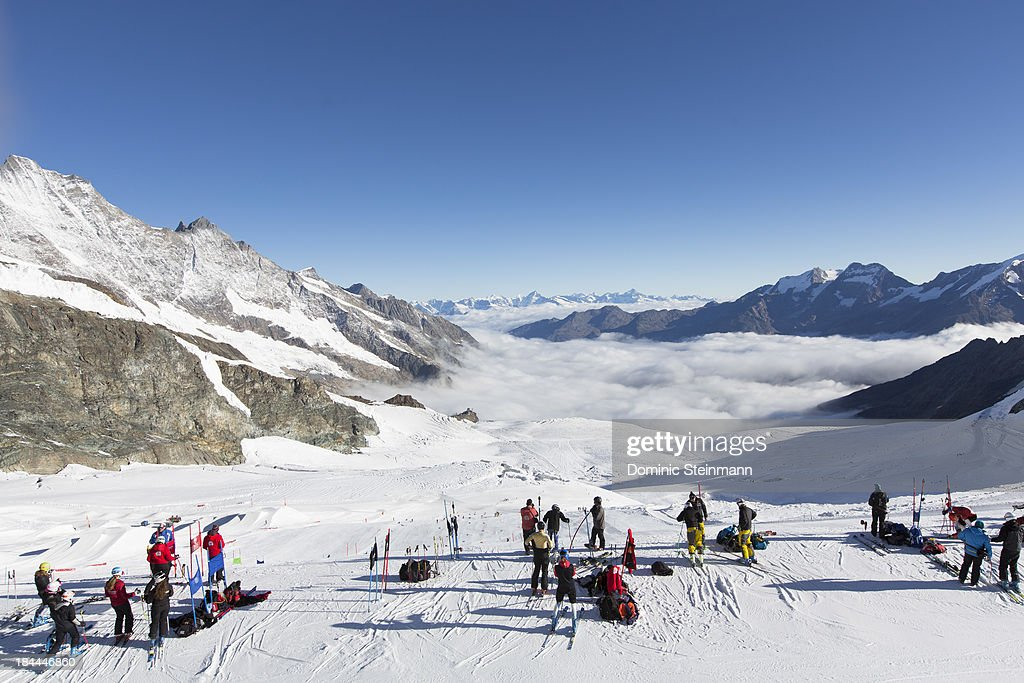 Ski athletes and coaches on the top of the slalom course on the Fee glacier on September 13, 2013 in Saas-Fee, Switzerland.