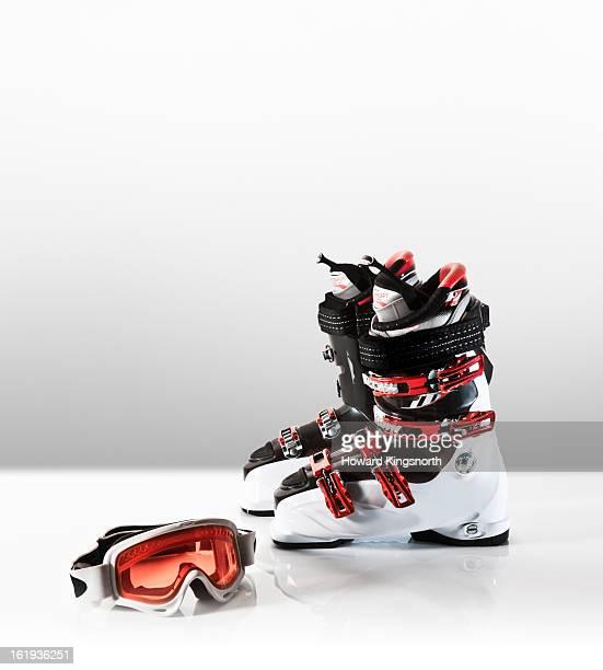 ski boots and goggles