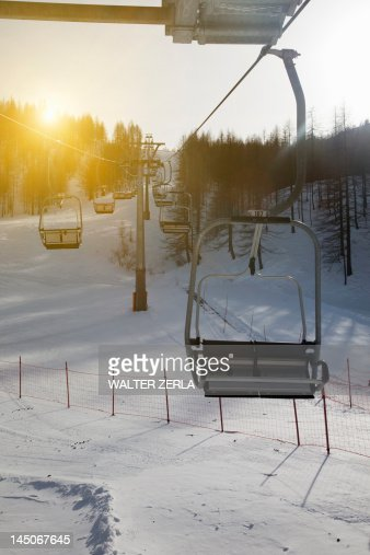 Ski chairlift over snowy landscape