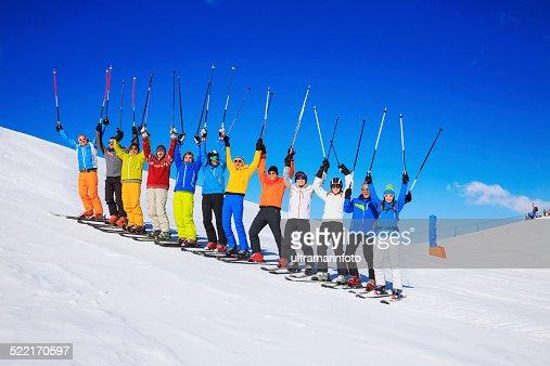 Ski club school skiing trips   Colorful group of snow skiers