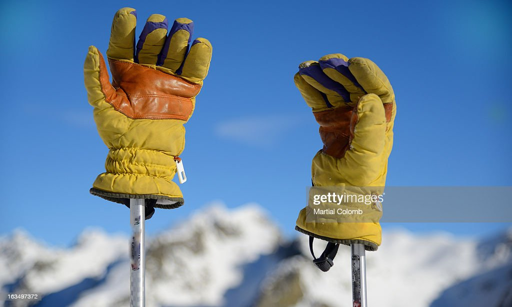 Ski gloves and mountains