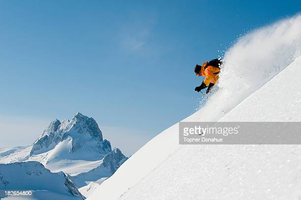 A ski guide powder skiing.
