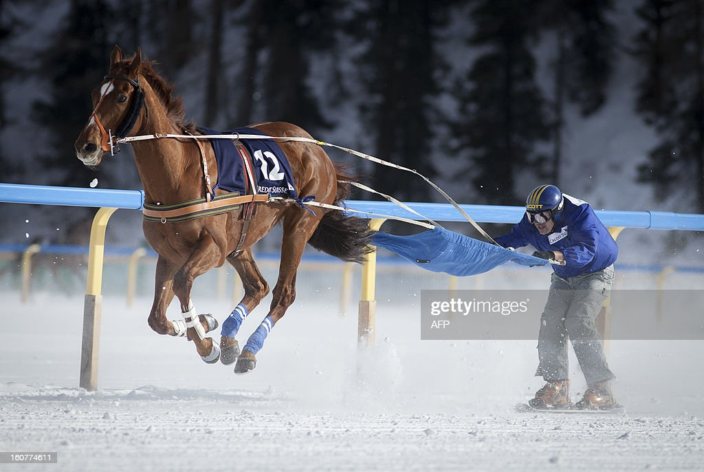 PEDRERO - A ski joering competitor takes part in the White Turf horse racing event in St. Moritz on February 3 , 2013. The races are held on the frozen lake of the Swiss mountain resort.