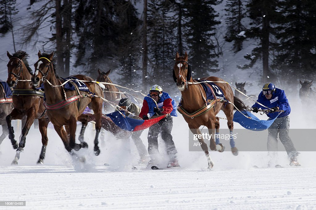 Ski joring racers take the last turn during the White Turf horse racing event in St. Moritz on February 3, 2013. The races are held on the frozen lake of the Swiss mountain resort.