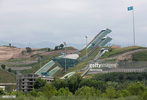 Ski jump ramps sit on a hill at the Sunkar International Ski Jumping Complex in Almaty Kazakhstan on Saturday June 27 2015 Almaty with a population...