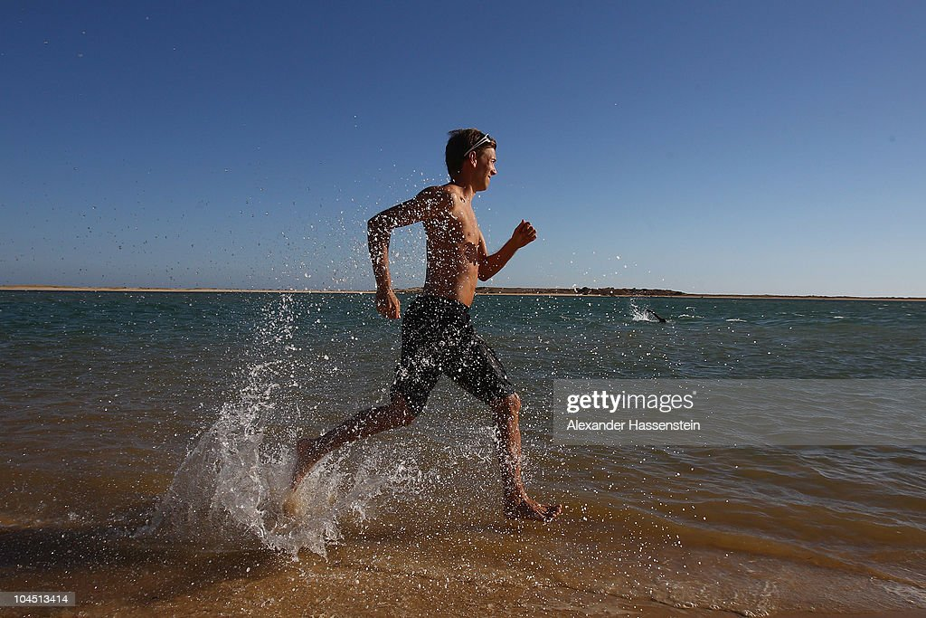 Ski jumper <a gi-track='captionPersonalityLinkClicked' href=/galleries/search?phrase=Michael+Neumayer&family=editorial&specificpeople=800790 ng-click='$event.stopPropagation()'>Michael Neumayer</a> runs on the beach during the 'Champion des Jahres' event week at the Robinson Club Quinta da Ria on September 28, 2010 in Quinta da Ria, Portugal. More than 70 top German athletes were invited by German holiday resort operator Robinson and German Sports Foundation (Deutsche Sporthilfe) to relax at the Robinson Club resort for a week's holiday after the season, as part of the company's 'Champion of the Year' competition.