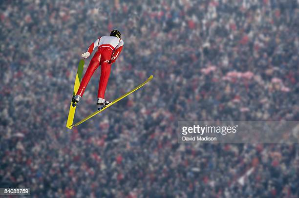 Ski jumper over crowd