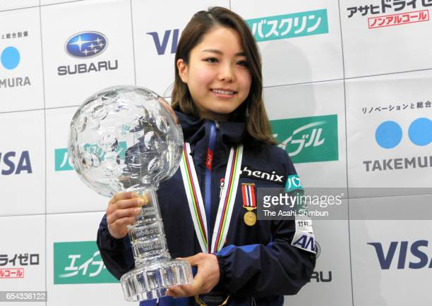 Ski jumper Sara Takanashi of Japan poses with the season champion trophy on arrival at Haneda International Airport on March 14 2017 in Tokyo Japan