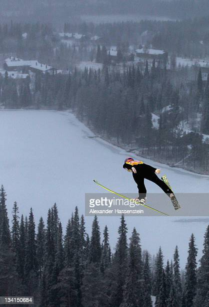 A ski jumper soars through the air during the large hill team ski jumping event at the FIS World Cup Nordic Opening 2011 on November 27 2011 in...