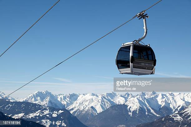 Ski lift and blue sky over European Alps panorama (XXXL)