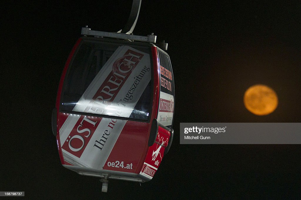 A ski lift goes past a yellow coloured moon during the Audi FIS Alpine Ski World Cup Slalom Race on December 29, 2012 in Semmering, Austria.