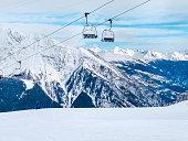 ski lift, slopes and mountains panorama of winter ski resort Chamonix, French Alps