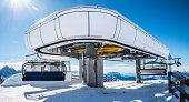 Modern ski lift upper station in the sunshine in Alps