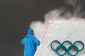 A ski marshall sprays carbon dioxide on the kicker prior to the Freestyle Skiing women's aerial finals at Cypress Mountain north of Vancouver during...