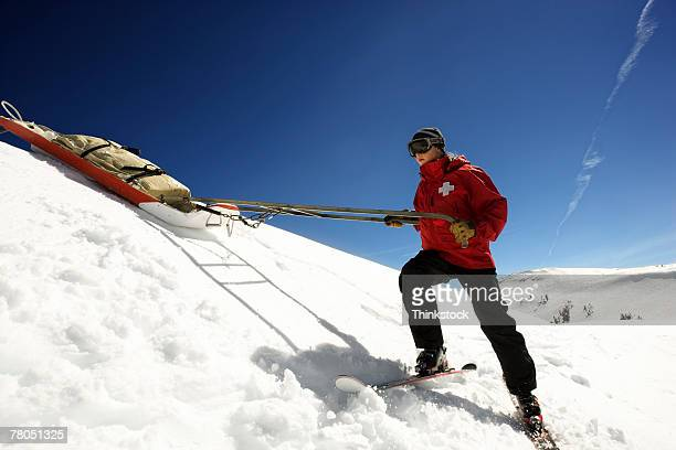 Ski patrol pulling supplies on sled