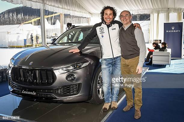 Ski star Giorgio Rocca and Maserati Switzerland CEO Piergiorgio Cecco pose near a Maserati Levante during Snow Polo World Cup St Moritz 2017 on...