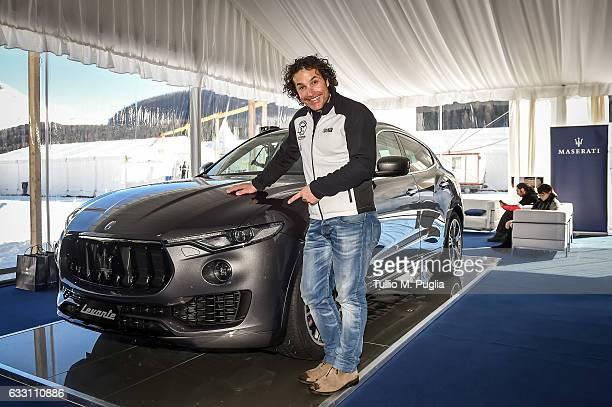Ski star Giorgio Rocca poses near a Maserati Levante during Snow Polo World Cup St Moritz 2017 on January 29 2017 in St Moritz Switzerland