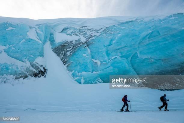 Ski touring past an ancient glacier