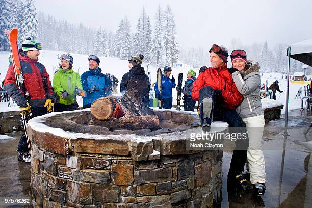 Ski vacation group portrait by outdoor firepit