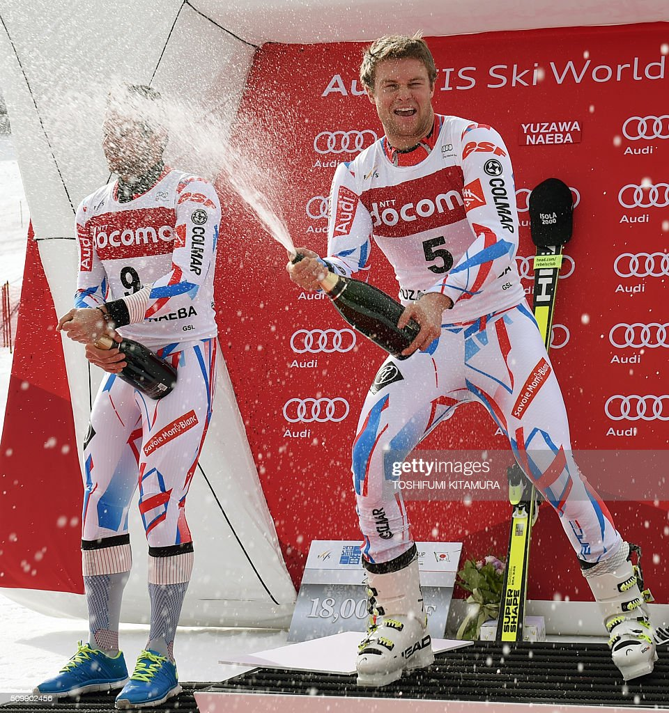 FIS Ski World Cup 2015/2016 6th men's giant slalom winner Alexis Pinturault of France (R) and second placer Mathieu Faivre of France (L) spray champagne on the podium in Naeba, Niigata prefecture on February 13, 2016. AFP PHOTO / TOSHIFUMI KITAMURA / AFP / TOSHIFUMI KITAMURA