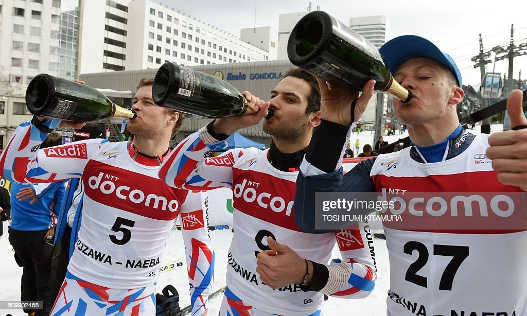 FIS Ski World Cup 2015/2016 6th men's giant slalom winner Alexis Pinturault of France (L), second place Mathieu Faivre of France (C) and third place Massimiliano Blardone of Italy (R) drink champagne after the podium ceremony in Naeba, Niigata prefecture on February 13, 2016. AFP PHOTO / TOSHIFUMI KITAMURA / AFP / TOSHIFUMI KITAMURA