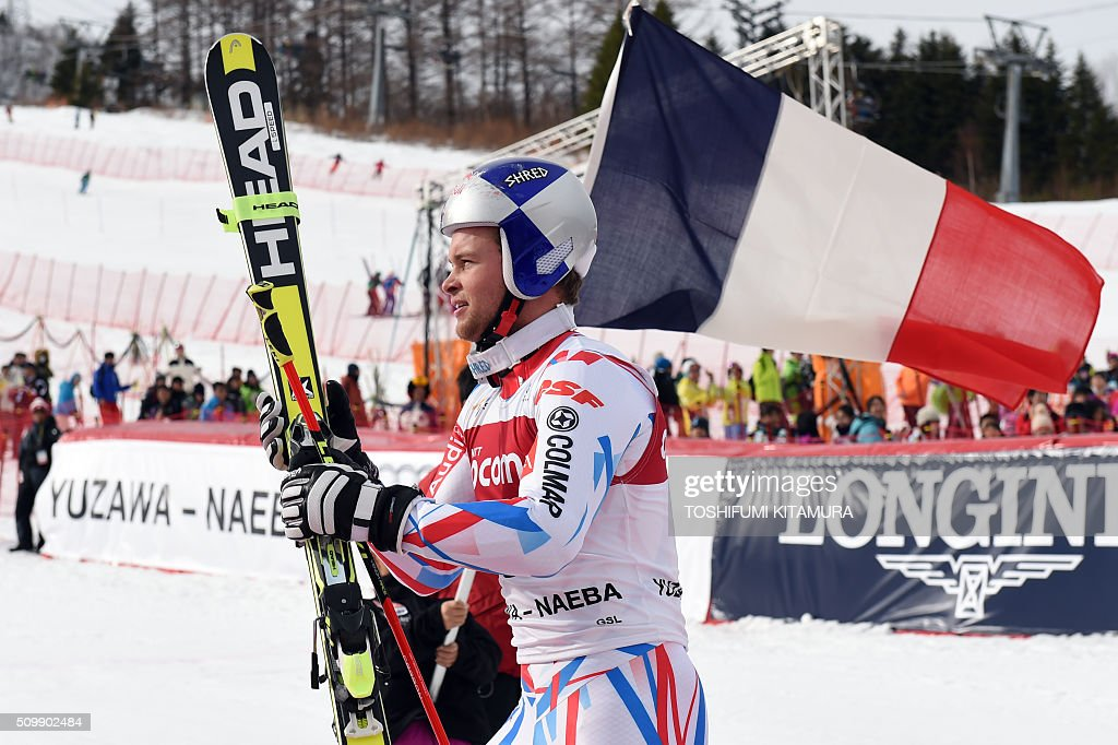 FIS Ski World Cup 2015/2016 6th men's giant slalom winner Alexis Pinturault of France walks towards the podium in Naeba, Niigata prefecture on February 13, 2016. AFP PHOTO / TOSHIFUMI KITAMURA / AFP / TOSHIFUMI KITAMURA