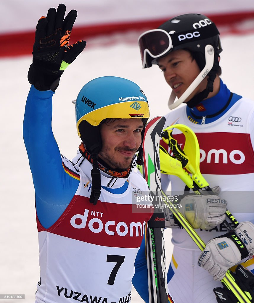 FIS Ski World Cup 2015/2016 men's slalom winner Felix Neureuter of Germany (L) acknowledges cheers beside second placed Andre Myhrer of Sweden (R) at the finishing area at the Naeba ski resort in Yuzawa town, Niigata prefecture on February 14, 2016. AFP PHOTO / TOSHIFUMI KITAMURA / AFP / TOSHIFUMI KITAMURA