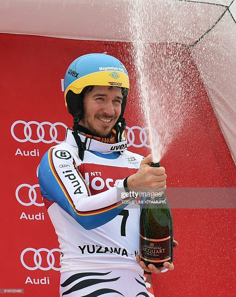 FIS Ski World Cup 2015/2016 men's slalom winner Felix Neureuter of Germany sprays champagne on the podium at the Naeba ski resort in Yuzawa town, Niigata prefecture on February 14, 2016. AFP PHOTO / TOSHIFUMI KITAMURA / AFP / TOSHIFUMI KITAMURA