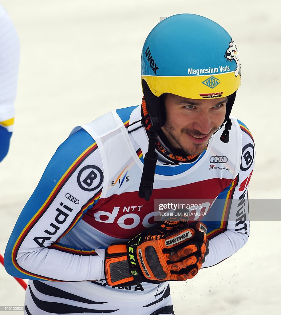 FIS Ski World Cup 2015/2016 men's slalom winner Felix Neureuter of Germany bows to acknowledge cheers at the finishing area at the Naeba ski resort in Yuzawa town, Niigata prefecture on February 14, 2016. AFP PHOTO / TOSHIFUMI KITAMURA / AFP / TOSHIFUMI KITAMURA
