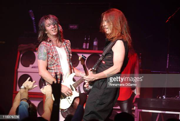 Skid Row's guitarists Snake and Scotti Hill during Skid Row 'Rock Never Stops' Tour 2002 at Visalia Convention Center in Visalia California United...