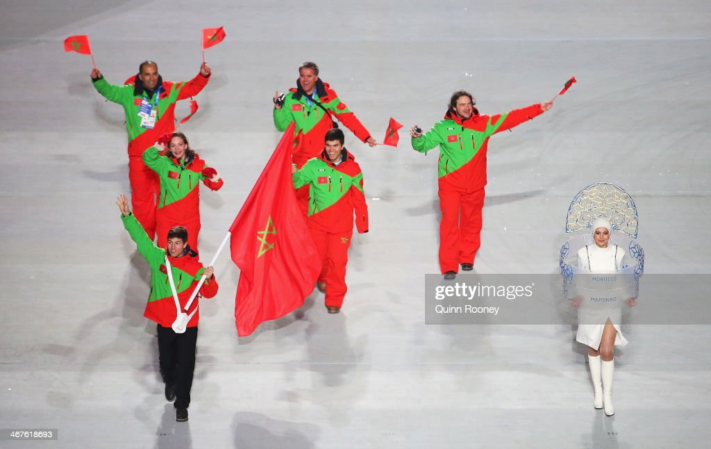 Skier Adam Lamhamedi of the Morocco Olympic team carries his country's flag during the Opening Ceremony of the Sochi 2014 Winter Olympics at Fisht Olympic Stadium on February 7, 2014 in Sochi, Russia.