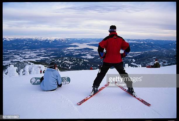 Skier and Snowboarder on Ski Slope