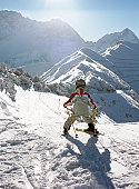 Skier at sunny ski resort
