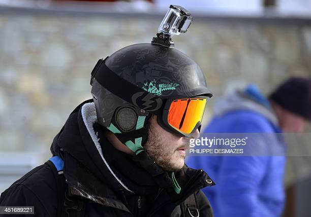A skier carrying a GoPro camera on his helmet is seen on November 24 2013 at Val Thorens in the French Alps during the ski station's opening weekend...