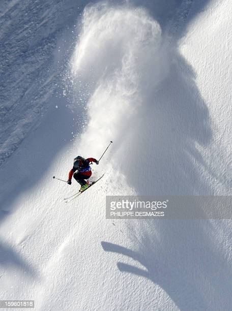 A skier competes during the 5th Linecatcher at the 'Cirque de Fond Blanc' on January 16 2013 in Les Arcs ski resort French Alps AFP PHOTO/PHILIPPE...