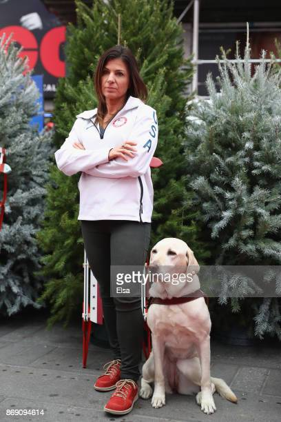 Skier Danelle Umstead and her guide dog Aziza pose for a photo during the 100 Days Out 2018 PyeongChang Winter Olympics Celebration Team USA in Times...