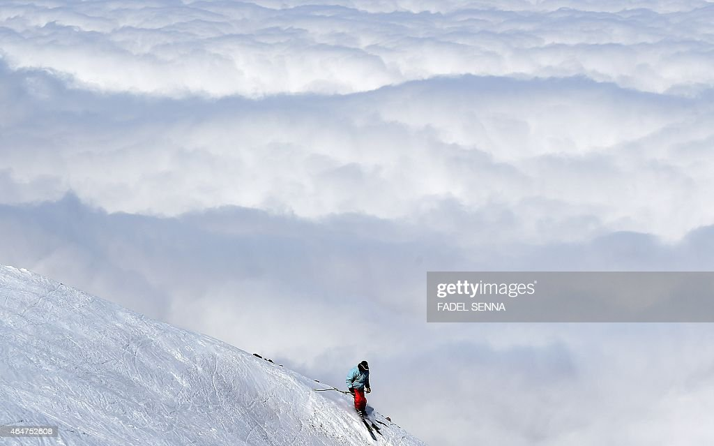 A skier descends a slope at the Oukaimeden ski resort, in the Atlas Mountains, 30 kilometres from the popular tourist resort of Marrakesh, on February 17, 2015.